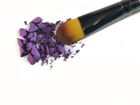 Make-up brush with colorful crushed eyeshadows  photo
