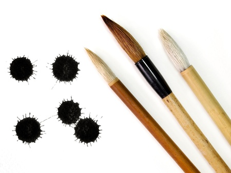 calligraphy: Chinese brushes with Ink splashes  Stock Photo