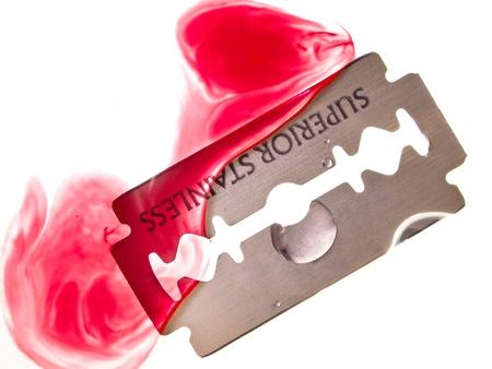 blade cut: Razor blade with drop of blood