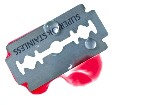Razor blade with drop of blood  photo