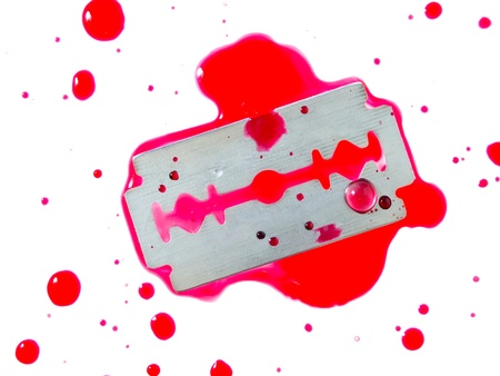 pain killers: Razor blade with drop of blood