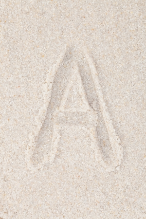 Alphabet writing on the sand - Letter A photo