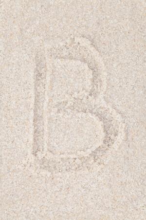 Alphabet writing on the sand - Letter B photo