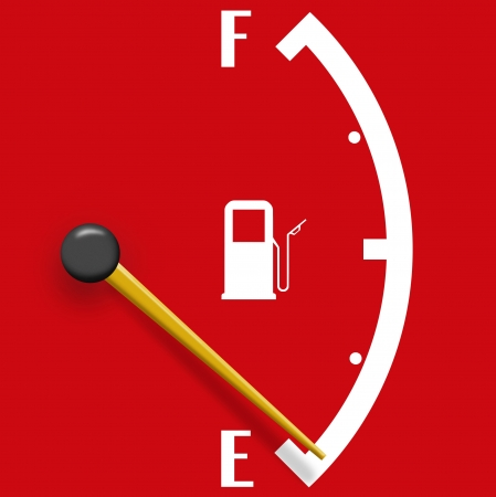 Low fuel sign isolated on a red background photo