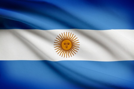 argentinean: Argentinean flag blowing in the wind. Part of a series.