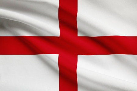 england flag: English flag blowing in the wind. Part of a series.