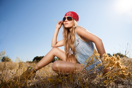 Beautiful romantic girl outdoors. Attractive young girl in a summer field. photo