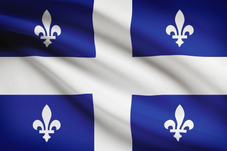 quebec city: Quebec flag blowing in the wind. Part of a series.