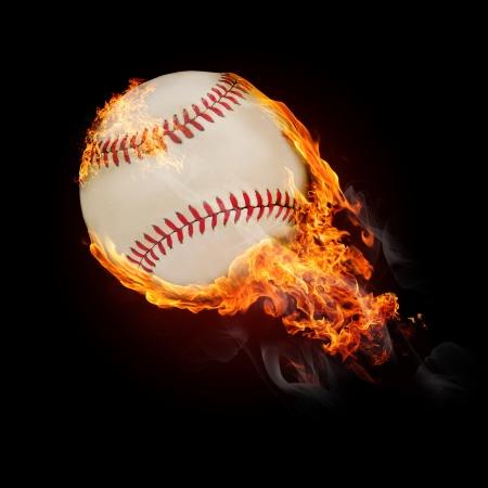 Flying baseball ball on fire - flying up photo
