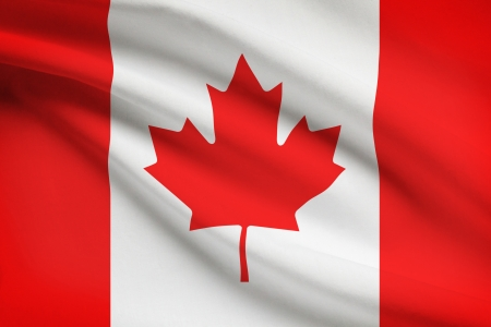canadian flag: Canadian flag blowing in the wind. Part of a series. Stock Photo