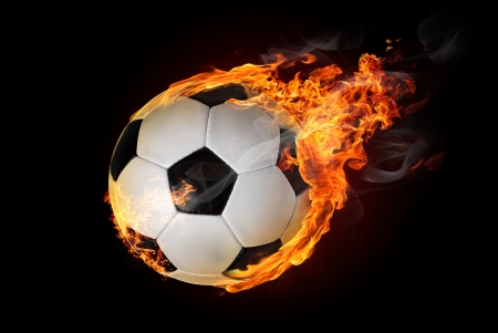 fast ball: Flying soccer ball on fire -falling down