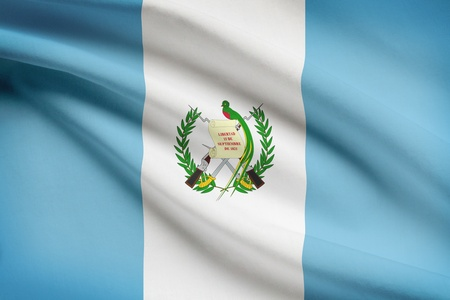 guatemalan: Guatemalan flag blowing in the wind. Part of a series.
