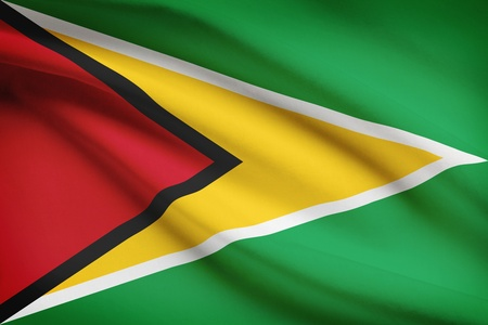 guyanese: Guyanese flag blowing in the wind. Part of a series. Stock Photo