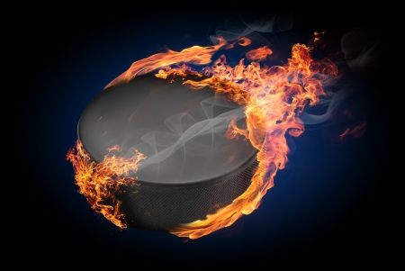 Hockey puck on fire flying down - illustration Stock Photo