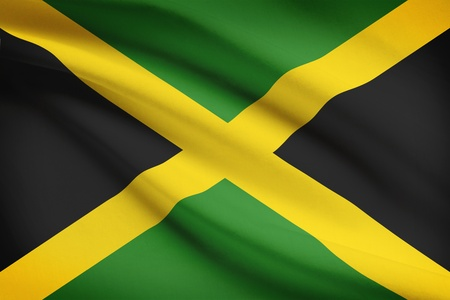 jamaican: Jamaican flag blowing in the wind. Part of a series. Stock Photo