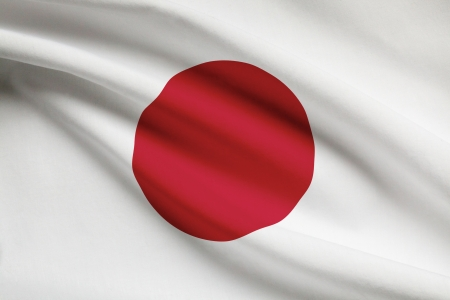 Japanese flag blowing in the wind. Part of a series. Banco de Imagens