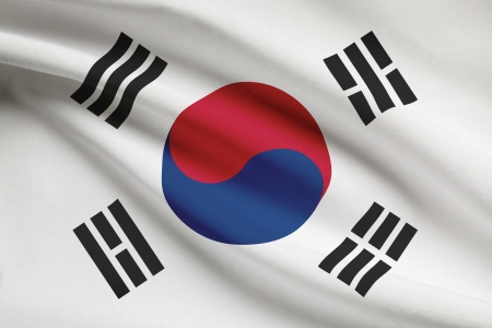 korean national: South Korean flag blowing in the wind. Part of a series. Stock Photo