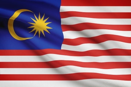 Malaysia flag blowing in the wind. Part of a series. Stock Photo