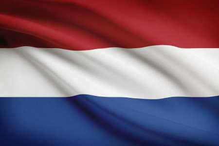 holland flag: Dutch flag blowing in the wind. Part of a series. Stock Photo