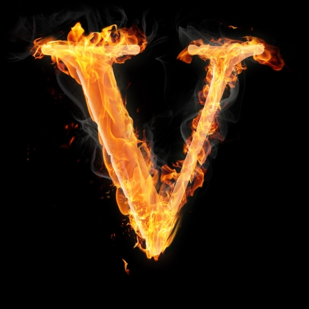 Letters and symbols in fire - Letter V. photo