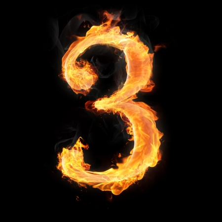 arithmetical: Burning numbers on black background - number three Stock Photo