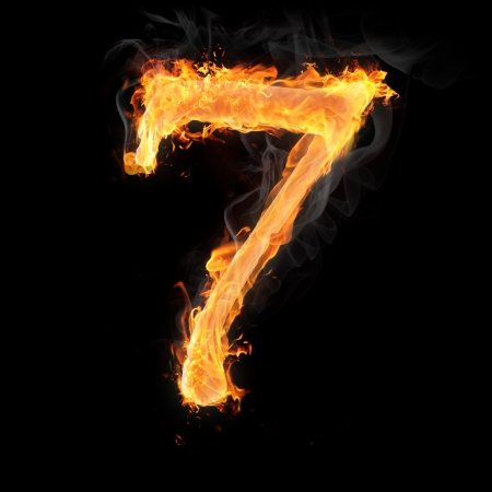 Burning numbers on black background - number seven Stock Photo