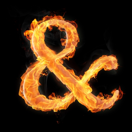 Ampersand mark in fire on black background photo