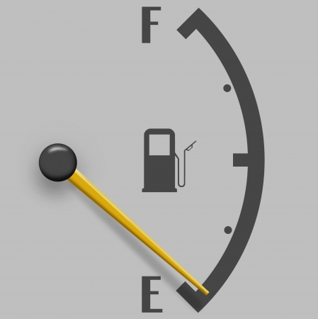 Low fuel sign isolated on a gray background photo