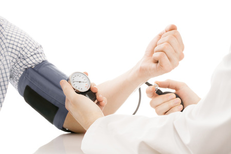 the high: Blood pressure measuring. Doctor measuring patients blood pressure - studio shoot isolated on white Stock Photo