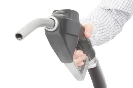 petrochemistry: Pistola de color negro de la bomba de combustible en la mano y aislado en blanco
