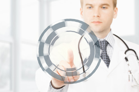 manipulating: Male doctor manipulating digital data with one finger Stock Photo