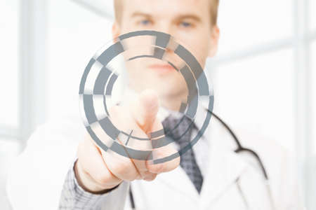 manipulating: Male doctor manipulating digital data with his finger