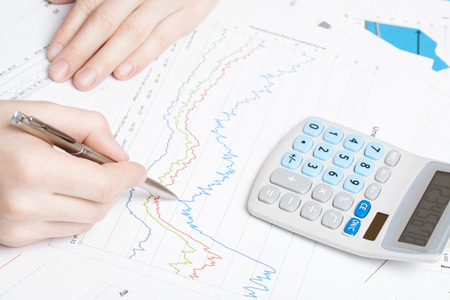 Man making financial calculations at the desk  photo