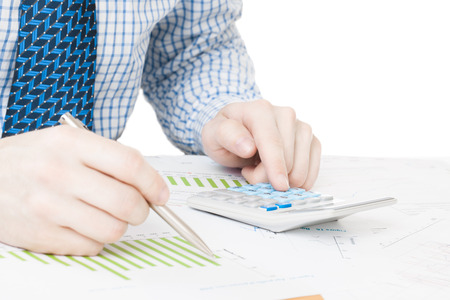 Male working with financial data at the desk photo
