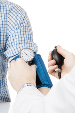 Blood pressure measuring tools. Doctor measuring patients blood pressure - studio shoot