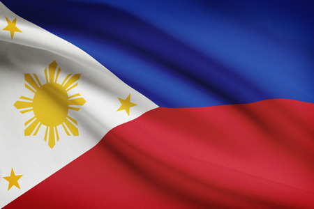 filipino: Filipino flag blowing in the wind. Part of a series.