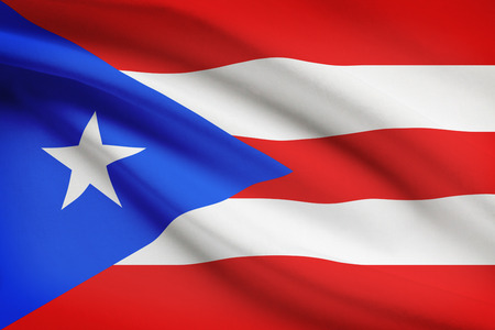 unincorporated: Puerto-Rican flag blowing in the wind. Part of a series.