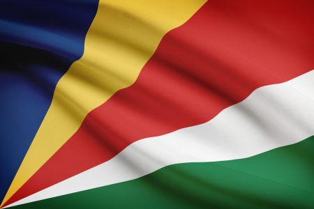 unitary: Seychelloise flag blowing in the wind. Part of a series. Stock Photo