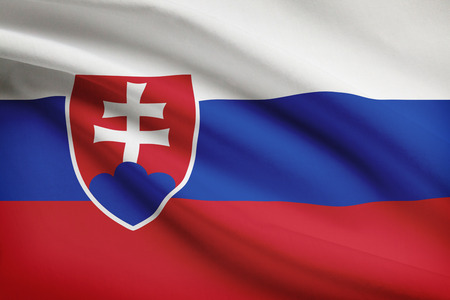 slovak: Slovak flag blowing in the wind. Part of a series. Stock Photo