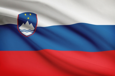 slovenian: Slovenian flag blowing in the wind. Part of a series. Stock Photo