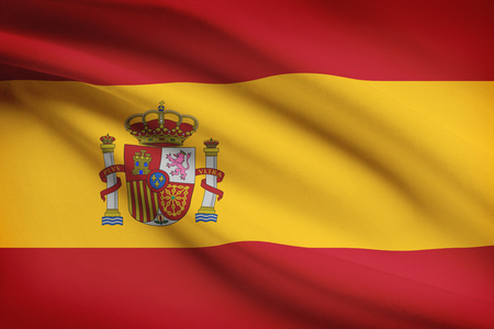 spaniard: Spanish flag blowing in the wind. Part of a series.