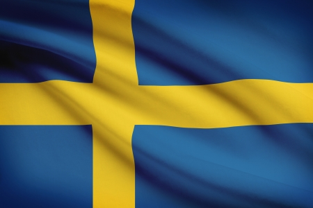 swedish: Swedish flag blowing in the wind. Part of a series.