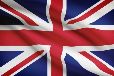 british flag: British flag blowing in the wind. Part of a series. Stock Photo