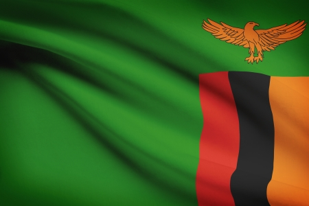 zambia: Zambian flag blowing in the wind. Part of a series. Stock Photo