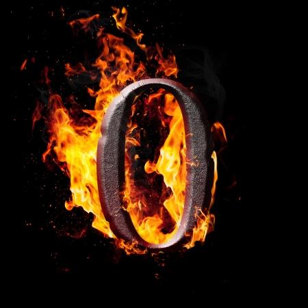 Hot metal burning numbers on black background - zero photo