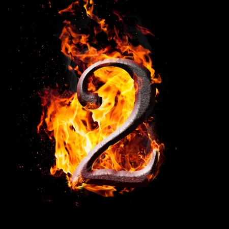 Hot metal burning numbers on black background - number two