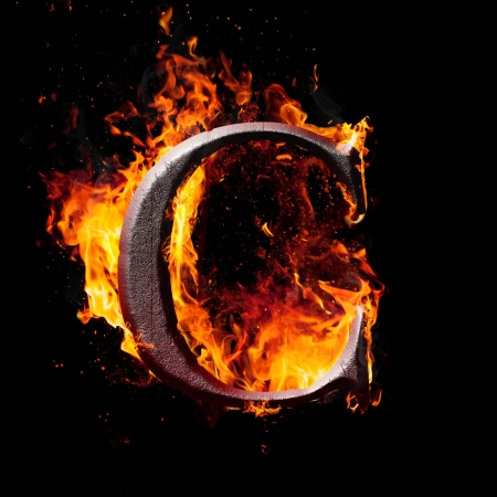 flame letters: Letters and symbols in fire - Letter C. Stock Photo