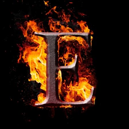 Las letras y los símbolos en el fuego - letra E. Foto de archivo - 24641883