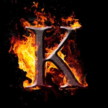 Letters and symbols in fire - Letter K. photo