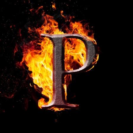 Letters en symbolen in het vuur - Brief P. Stockfoto